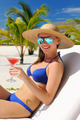 Woman at poolside with cosmopolitan cocktail - PhotoDune Item for Sale