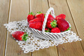 Ripe strawberries in ceramic basket on wooden background - PhotoDune Item for Sale