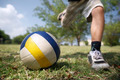 Kids playing soccer game, young boy hitting ball in park - PhotoDune Item for Sale