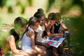 Children and education, kids and girls reading book in park - PhotoDune Item for Sale