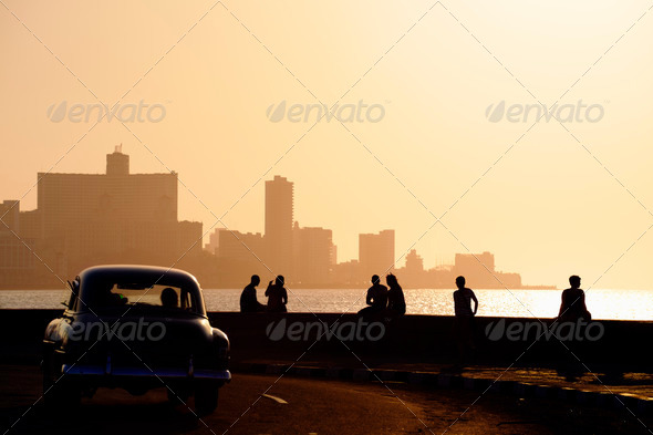 People and skyline of La Habana, Cuba, at sunset - Stock Photo - Images