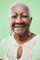 Portrait of senior black woman smiling at camera on green backgr - PhotoDune Item for Sale