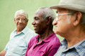 Group of old black and caucasian men talking in park - PhotoDune Item for Sale