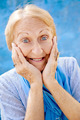 Portrait of surprised senior woman with hands on face on blue ba - PhotoDune Item for Sale