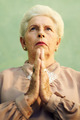 Portrait of serious old caucasian woman praying god