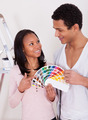 African Couple Choosing Color For New Home - PhotoDune Item for Sale