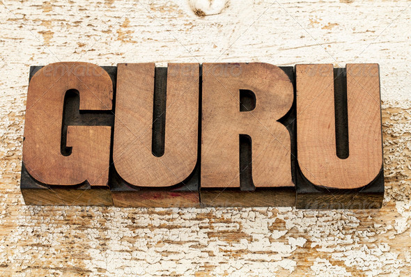 guru word in wood type - Stock Photo - Images