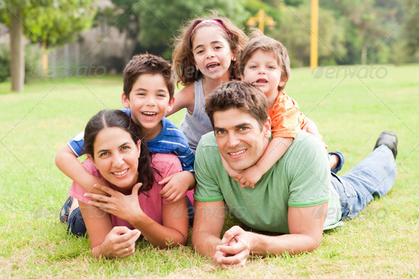 PhotoDune Happy family lying in the park 486326