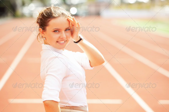 Business woman sport manager at athletic stadium - Stock Photo - Images