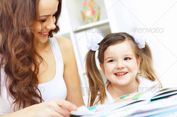 Mother and daughter studying - Stock Photo - Images