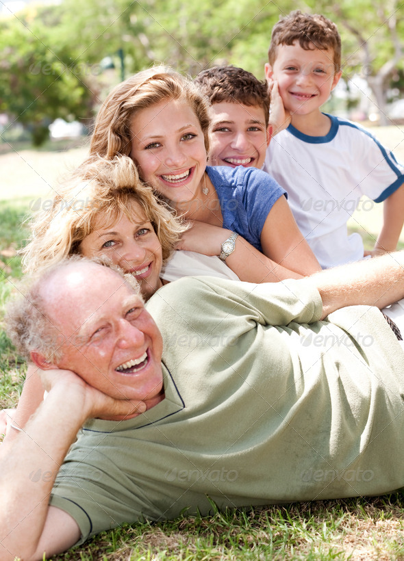 Multi-generation family realxing in park - Stock Photo - Images