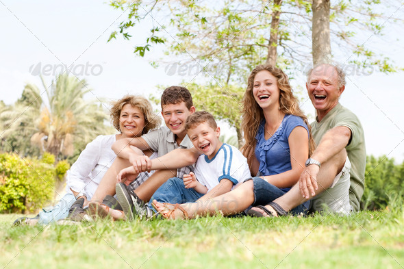 Affectionate family having fun outdoors - Stock Photo - Images