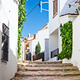 Typical narrow street in Calella de Palafrugell, costa Brava, Ca - PhotoDune Item for Sale