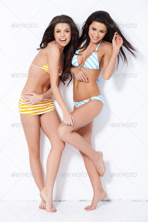 Two brunette sweeties smiling while posing - Stock Photo - Images