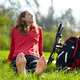 Happy girl biker enjoying relaxation sitting barefoot in green grass - PhotoDune Item for Sale