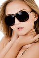Fashion shot of a beautiful women with sunglasses - PhotoDune Item for Sale