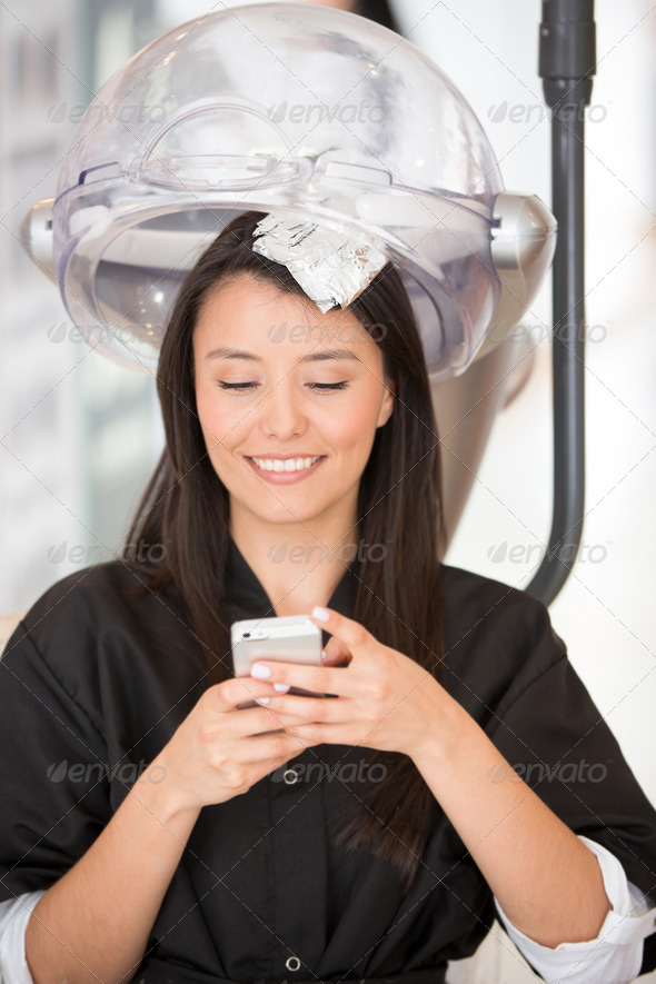Woman at the hairdresser - Stock Photo - Images