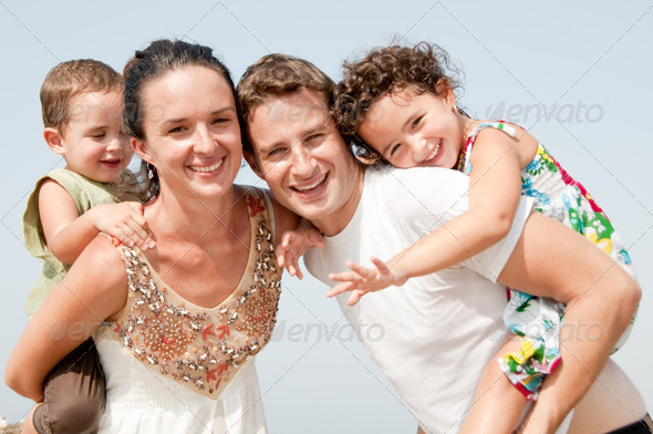 family in the beach - Stock Photo - Images