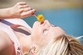 Woman smelling yellow dandelion - PhotoDune Item for Sale