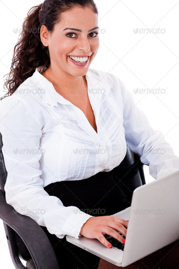 Smiling business woman with laptop - Stock Photo - Images