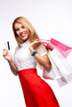 Portrait of woman with shopping bags and card - PhotoDune Item for Sale