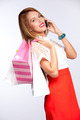 woman with shopping bags talking on mobile - PhotoDune Item for Sale