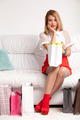 full-length portrait of woman on couch with shopping bags - PhotoDune Item for Sale