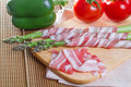 Bacon and asparagus on a wooden background - PhotoDune Item for Sale