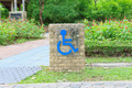 Handicap Sign in a park - PhotoDune Item for Sale