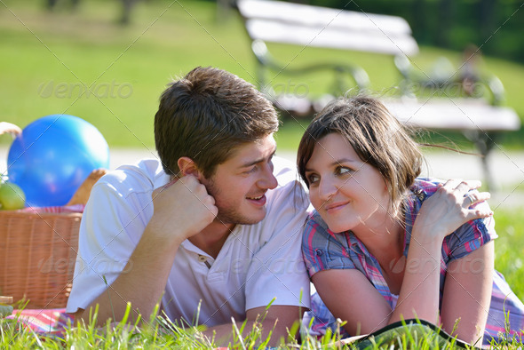 happy young couple having a picnic outdoor - Stock Photo - Images