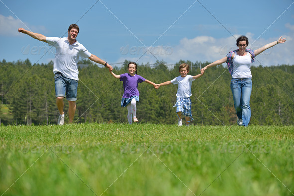 happy young family have fun outdoors - Stock Photo - Images