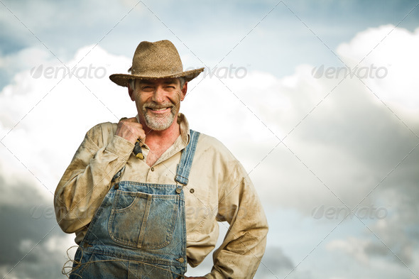 1930s farmer smiling at the camera - Stock Photo - Images