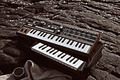 Music synthesizer lying on rocks close up - PhotoDune Item for Sale