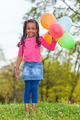 Outdoor portait of a cute young  little black girl playing with - PhotoDune Item for Sale