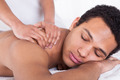 Man Receiving Massage From Female Hand - PhotoDune Item for Sale