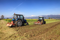 tractors plowing a field - PhotoDune Item for Sale
