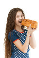 schoolgirl biting off piece of bread - PhotoDune Item for Sale