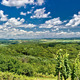 Green landscape panorama under blue sky - PhotoDune Item for Sale