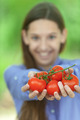 Smiling teenage girl holding red tomatoes - PhotoDune Item for Sale
