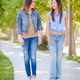 Young Adult Mixed Race Twin Sisters Walking Together Outside. - PhotoDune Item for Sale