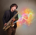Attractive musician playing on saxophone with colorful abstract - PhotoDune Item for Sale