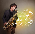 Handsome musician playing on saxophone with musical notes - PhotoDune Item for Sale