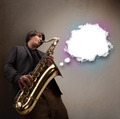 Young man playing on saxophone with copy space in white cloud - PhotoDune Item for Sale