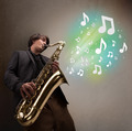 Young musician playing on saxophone while musical notes explodin - PhotoDune Item for Sale