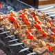 Shish kebab: slices of meat with sauce preparing on fire - PhotoDune Item for Sale