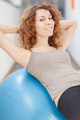Young woman doing exercise with a gym ball - PhotoDune Item for Sale
