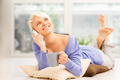 Smiling woman with mug on the floor while phoning - PhotoDune Item for Sale