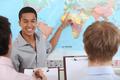 Teacher in geography class