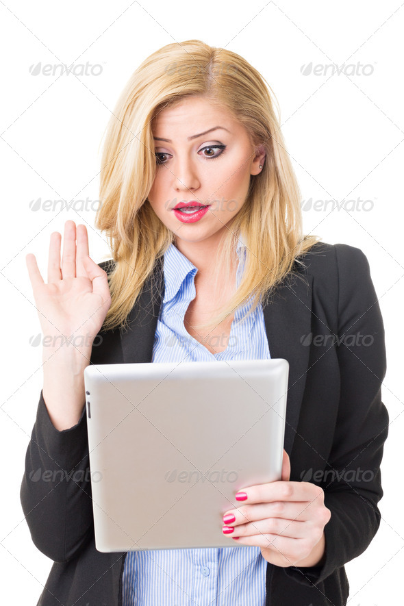 Surprised businesswoman with tablet computer - Stock Photo - Images