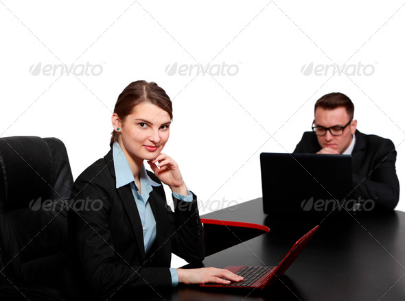 Young Business Couple on Laptops - Stock Photo - Images